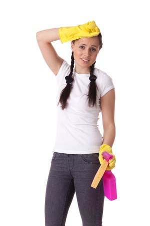 Young woman with spray bottle and sponge on a  white background.  Housekeeping. Stock Photo - 9070108