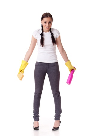Young woman with spray bottle and sponge on a  white background.  Housekeeping. photo