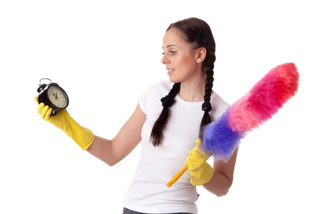 Young woman with alarm clock and whisk on a  white background.  Housekeeping. Stock Photo - 9070107