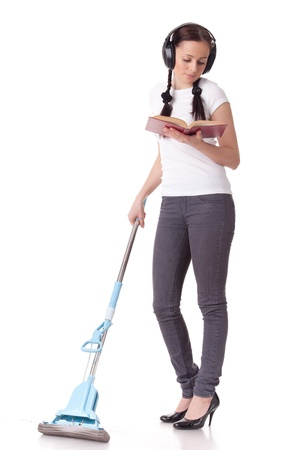Young woman with mop and book on a white background. Housekeeping. Stock Photo - 9070094