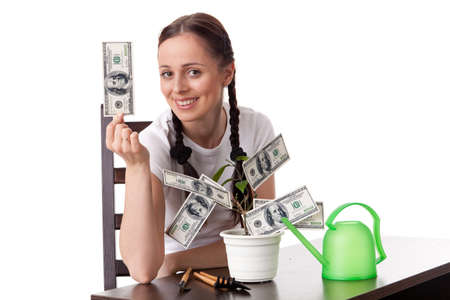 commercial tree care: Young woman with money tree on a white background. Concept financial growth. Stock Photo