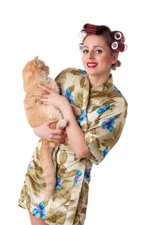 Happy young woman with a yellow cat on a white background. photo