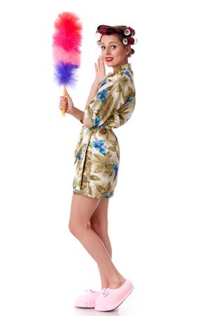 Young woman with whisk on a white background. Housekeeping. photo