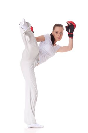 girl action: Sporty young woman in red fighting gloves on a white background.