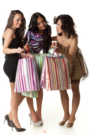 Young happy women with shopping bags  on a white background. Sale. photo