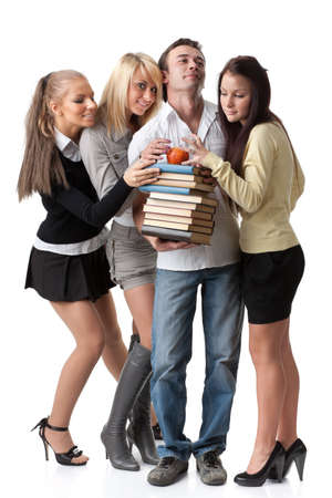 Male student with books and an apple among beautiful female students. photo