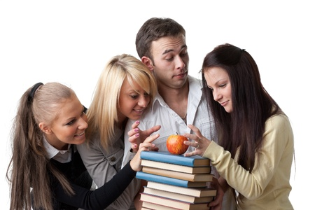Male student with books and an apple among beautiful female students. Stock Photo - 9251978