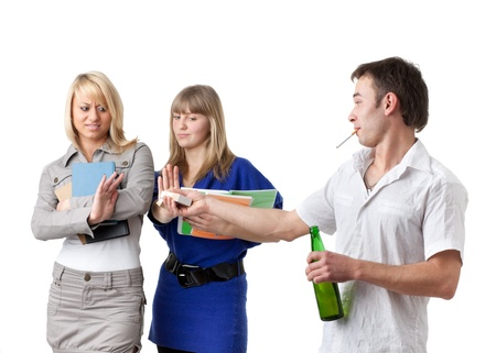 Clever female students do not approve the guy with a bottle of beer and a cigarette on a white background. Stock Photo - 9251984