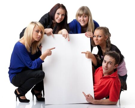 The group of young people holds the empty board for the text on a white background. Stock Photo - 9251987
