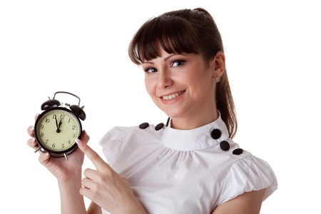 Young woman with alarm clock on a white background. photo