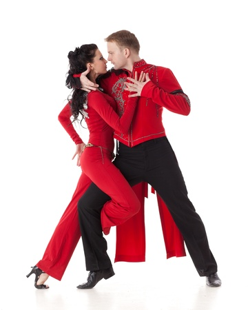 vigorously: Dancing young couple on a white background. Stock Photo