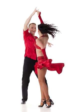 salsa dancer: Dancing young couple on a white background. Stock Photo