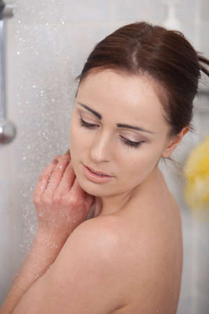 Portrait of a beautiful young woman in a bathroom. Concept  of body care. photo