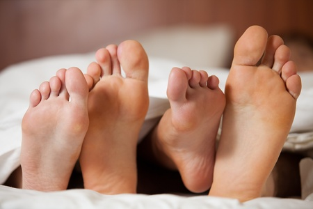Happy young couple sleeps on  the bed at home. Stock Photo - 9421445