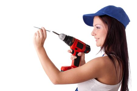 Young woman in overalls with screw and screwdriver on a white background. photo