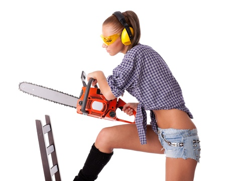 female sexy chains: The young woman with a chainsaw on a white background. Stock Photo
