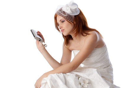 unloved: Unhappy young woman in a wedding dress on a white background. Stock Photo