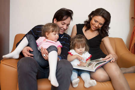 Young parents with their  children at home. Happy family. Stock Photo - 9529327
