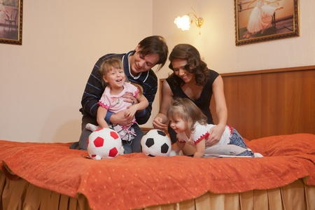 Young parents with their  children at home. Happy family. Stock Photo - 9523726