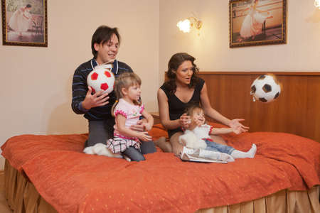 Young parents with their  children at home. Happy family. Stock Photo - 9529325
