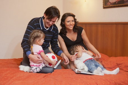Young parents with their  children at home. Happy family. photo