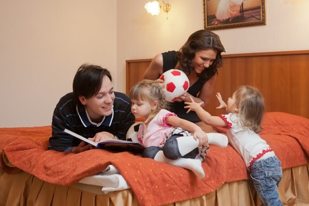Young parents with their  children at home. Happy family. Stock Photo - 9529326