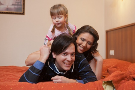 Young parents with their  children at home. Happy family. Stock Photo - 9529319