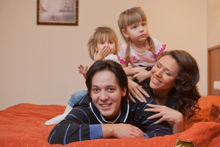 Young parents with their  children at home. Happy family. Stock Photo - 9529321