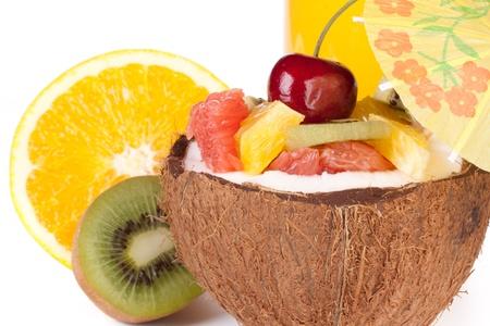Fresh fruit salad and juice on a white background. Dessert. photo
