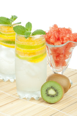 Summer fruity drink with ice on a white background. photo