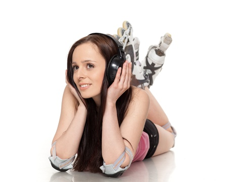 The beautiful young woman in rollerskates on a white background. photo