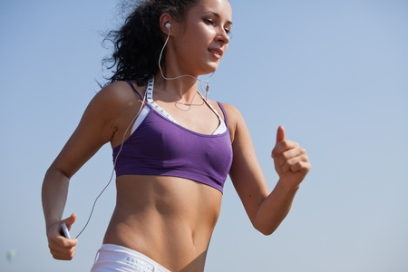 Young woman running on summer day. Concept of healthy lifestyle.