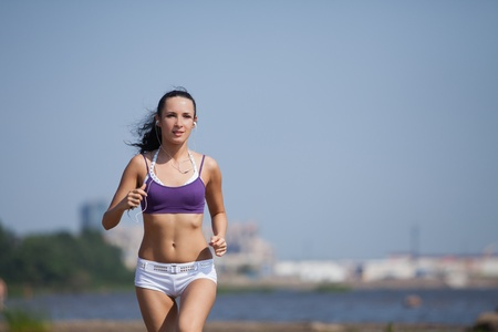 Young woman running on summer day.