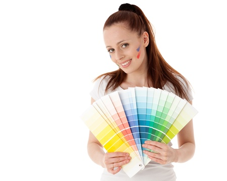 The beautiful young woman with a color guide on a white background. Designer of interior. photo