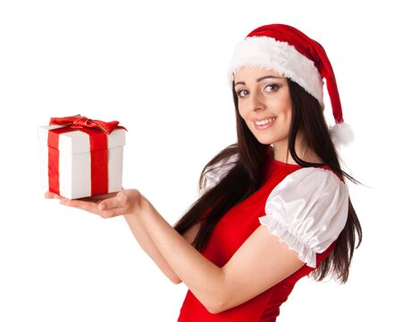 The beautiful young woman in a Santa's cap  with a gift  on a white background. Stock Photo - 11923233