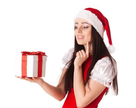 The beautiful young woman in a Santas cap  with a gift  on a white background. photo