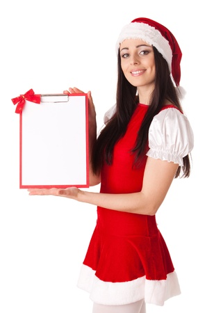 Pretty young woman in Santas suit with clipboard on a white background. photo
