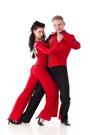 salsa dance: Dancing young couple on a white background. Stock Photo