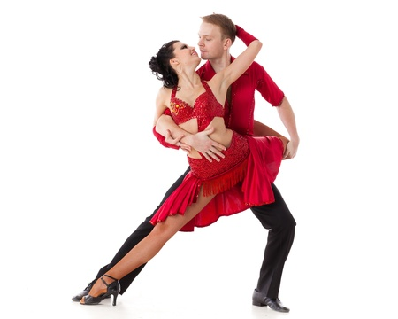 ballroom dancing: Dancing young couple on a white background. Stock Photo