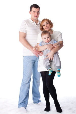 Young parents with their sweet  baby on a white background. Happy family. Stock Photo - 12024578
