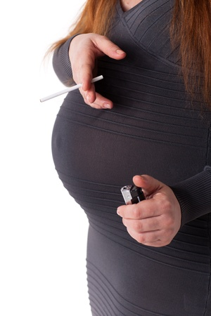 The pregnant woman with a cigarette on a white background photo