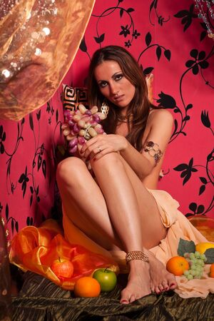 Young beautiful woman with fruit. East style. photo