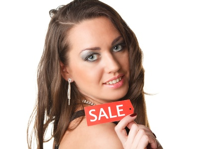 Beautiful young woman showing SALE sign on a white background. photo