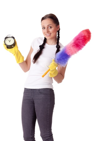 office cleanup: Young woman with alarm clock and whisk on a  white background.  Housekeeping.