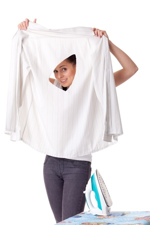 discomfiture: Young woman with shirt and iron on a white background. Housekeeping.