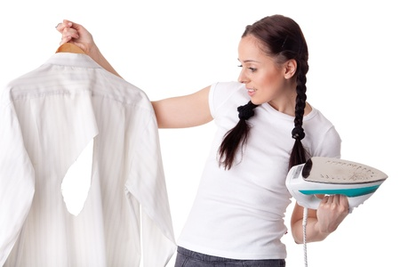 Young woman with shirt and iron on a white background. Housekeeping. photo