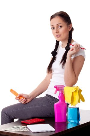 The young housewife plans the family budget on a white background. Stock Photo - 13159442