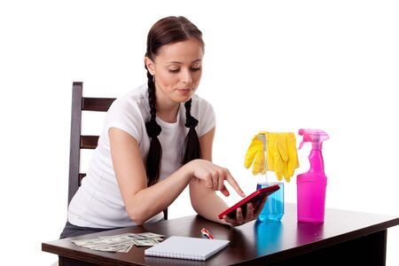 The young housewife plans the family budget on a white background. photo