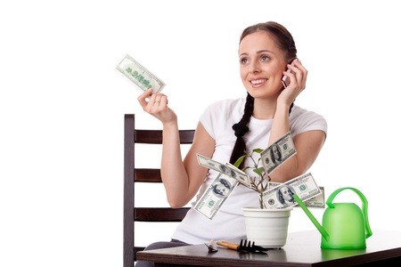Young woman with money tree on a white background. Concept financial growth. photo