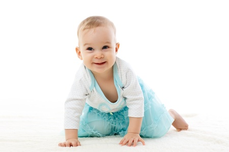 Sweet small baby girl on a white background  photo